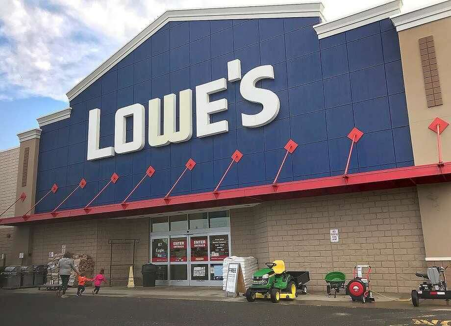 Customers walk into the Lowe's home improvement store in Danbury in 2017.