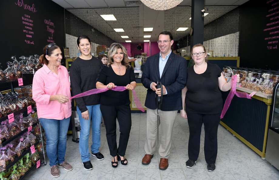 From left, customer Bela DeBrum of Milford, manager Lisbeth Fortin, owner Kathy Klein, Milford Mayor Ben Blake and cupcake manager Sally Hehn take part in a ribbon cutting for Kathy's Famous Cookies at their new location at 1365 New Haven Avenue in Milford.