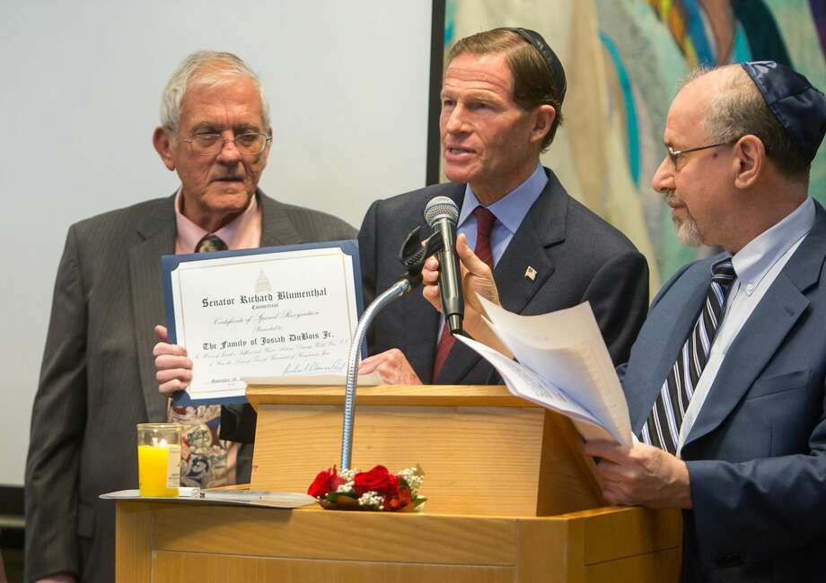 Sen. Richard Blumenthal, center, and Rabbi Alvin Wainhaus, right, present a Senatorial Citation to Robert DuBois, son of Josiah Dubois.
