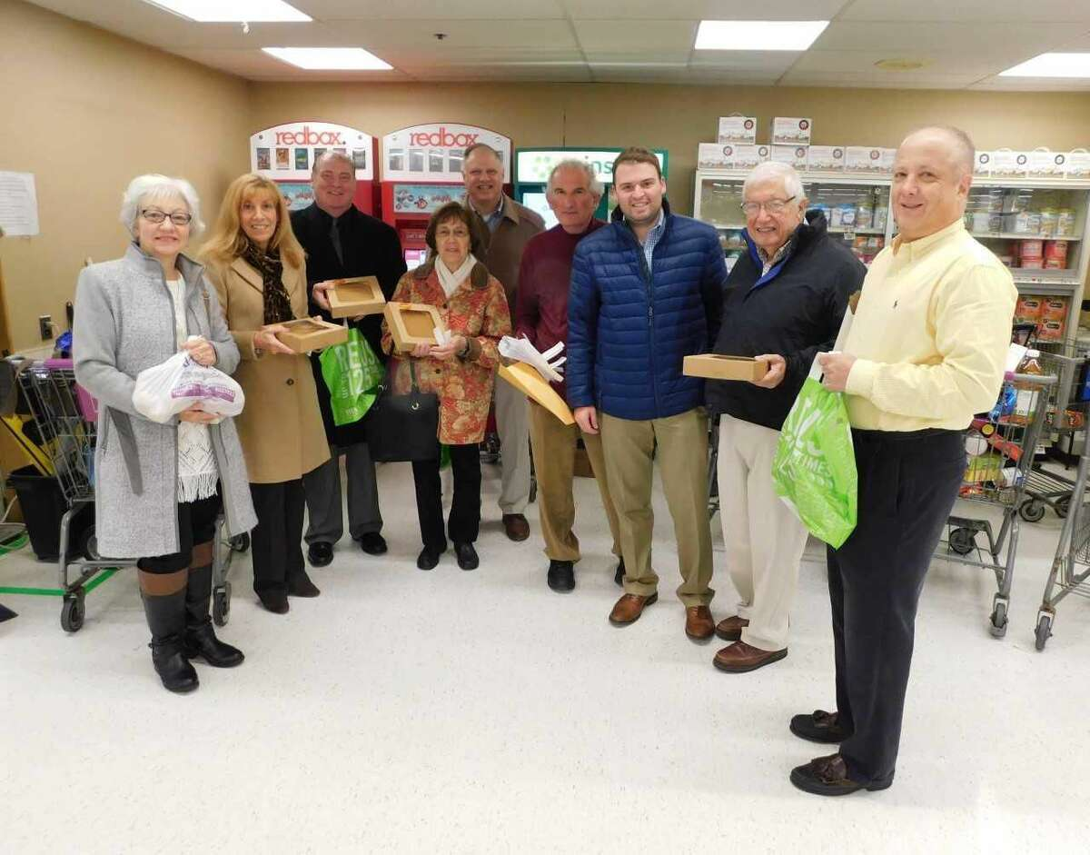 From left, Woodbridge Youth Services Director Nancy Pfund, Rotarians Mary Ellen LaRocca, Tony Anastasio, Dorothy Martino, Buddy DeGennaro, former Rotarian Peter Lerner who co-chaired the project, Woodbridge Rotary Club President Spencer Rubin, and Rotarians Dr. Guy Stella and Tom Shernow.