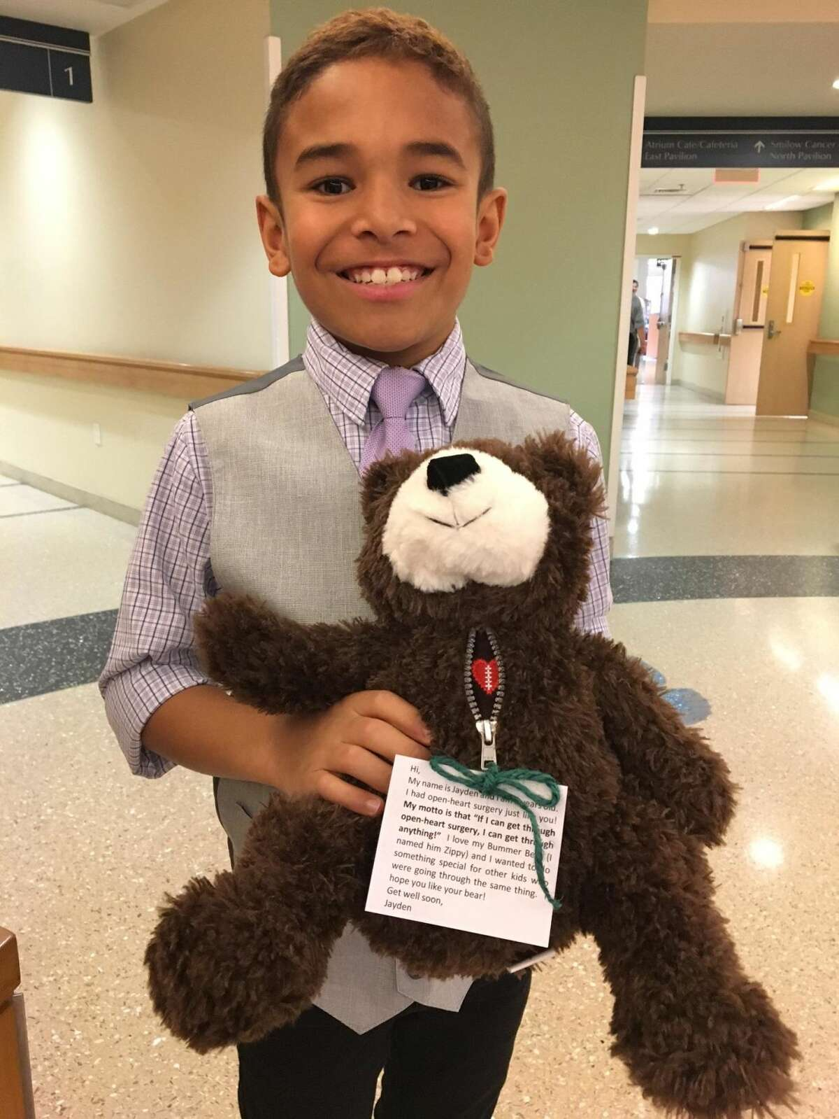 Derby resident Jayden Cooper, 9, holds one of the donated teddy bears.