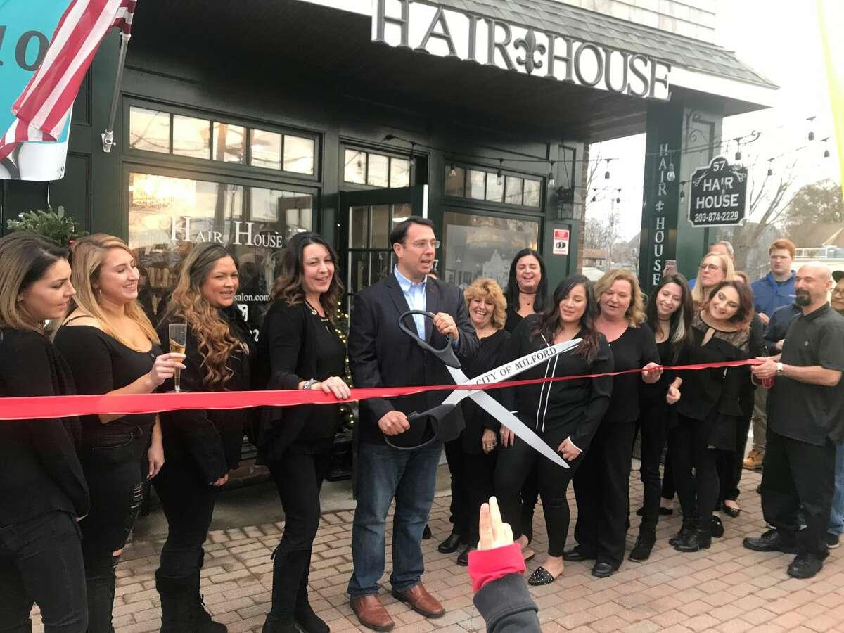 Mayor Ben Blake cuts the ribbon at Hair House.