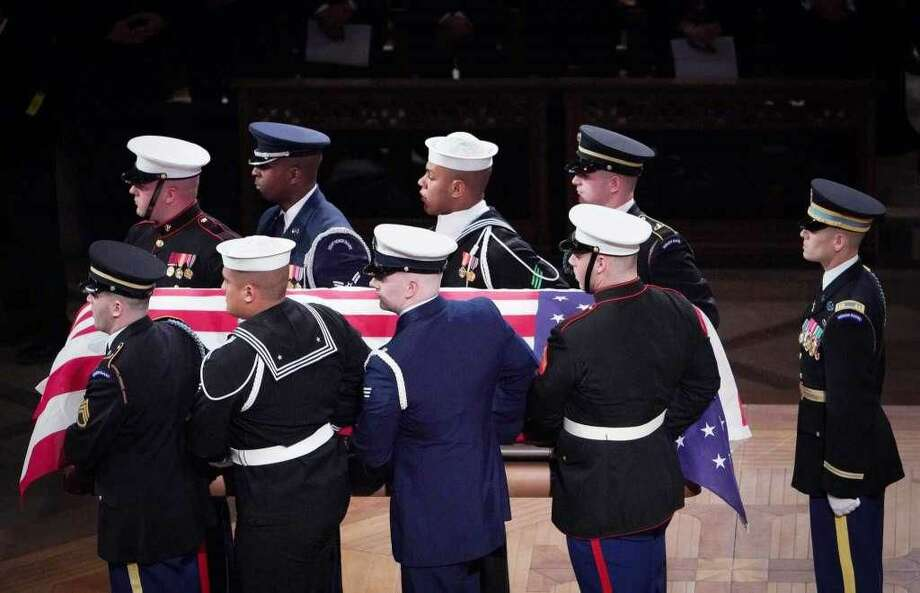 Allon C. Louisgene, a U.S. Navy sailor from Milford, was part of the military honor guard that carried the flag-draped casket of former President George H.W. Bush out after the State Funeral at the National Cathedral, Wednesday, Dec. 5, in Washington. Louisgene is the third member in the top row wearing the sailor's cap.
