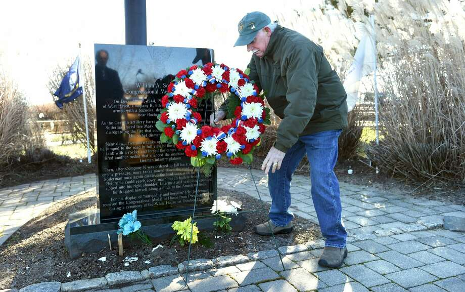 Vietnam veteran Dave Ricci of West Haven lays a wreath at the William A. Soderman Memorial Flagpole during a commemoration of the 77th anniversary of the Japanese bombing of Pearl Harbor at Bradley Point Park in West Haven on Dec. 7, 2018.