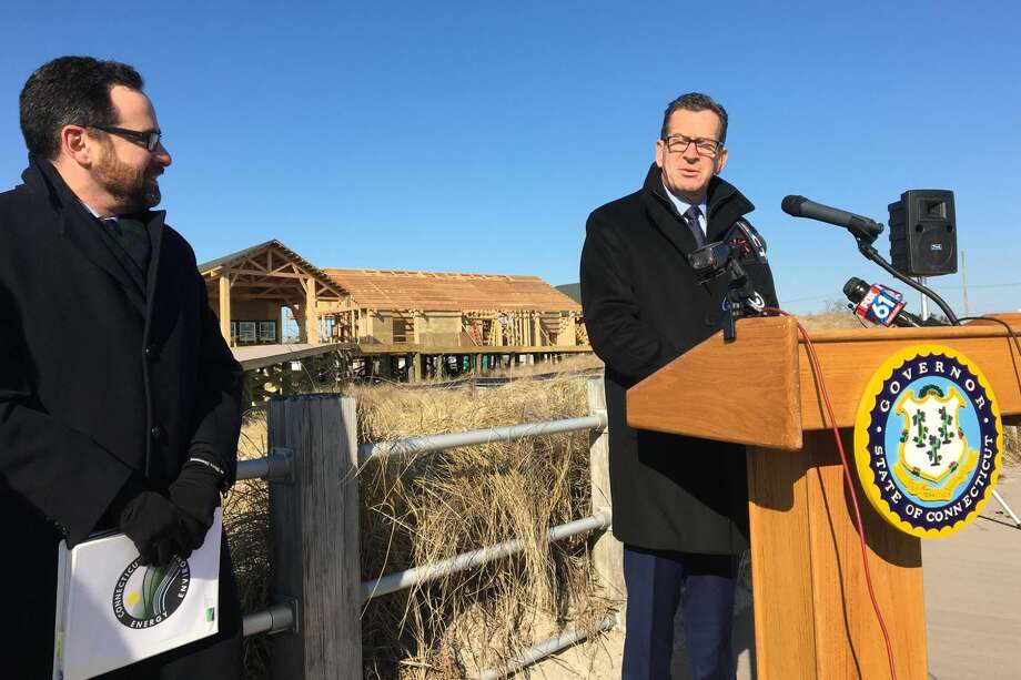 Gov. Dannel P. Malloy, right, and Commissioner of Energy and Environmental Protection Rob Klee, during a ceremony Monday, Dec. 10, commemorating the $10-million renovation and construction at Silver Sands State Park in Milford.