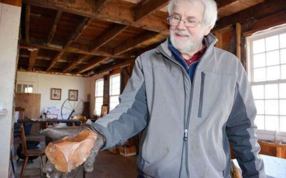 Tim Chaucer holds the Acheulean hand axe, which he believes is up to one million years old.