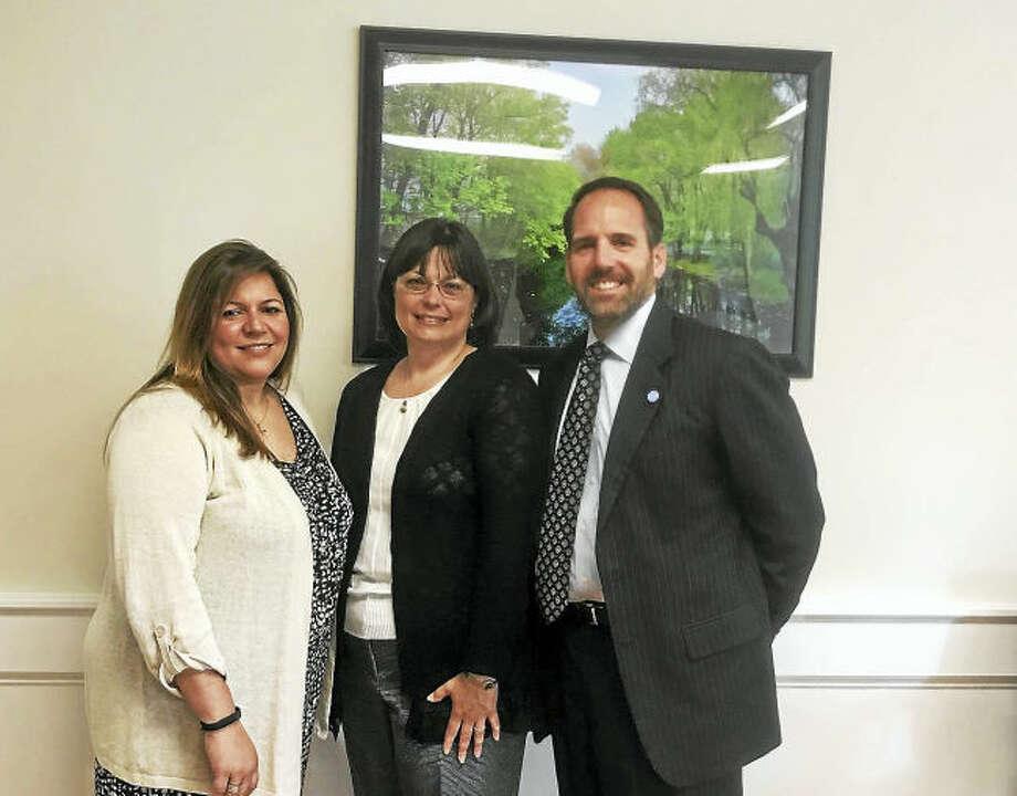 From left, Milford Human Resources Director Tania Barnes, Lynn Kelliher and City Attorney Jon Berchem.