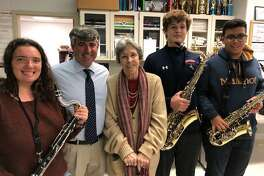 Students Michelle, Jackson and Joshua of the Brien McMahon High School Band, with Music Director Ron Secchi and Franca Mulligan, President of the Gerry & Franca Mulligan Foundation.