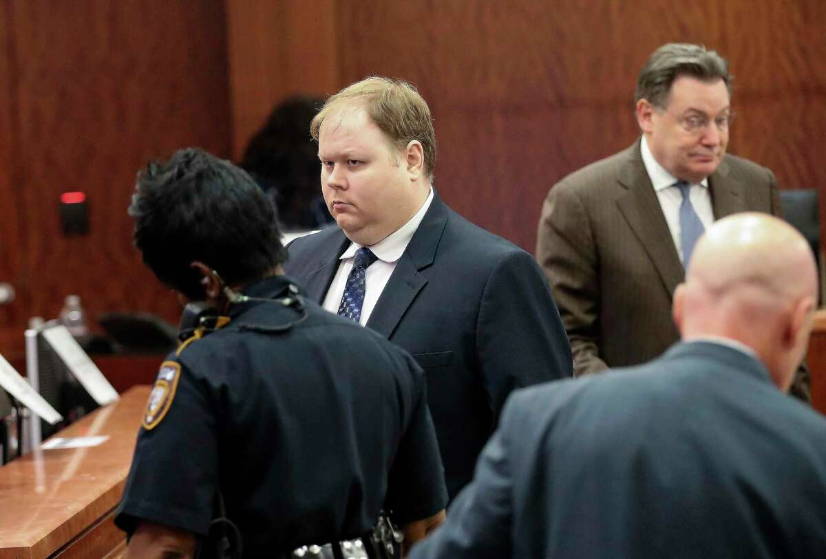 In this Aug. 27, 2019, file photo, Ronald Haskell, center, appears in Judge George Powell's courtroom for his capital murder trial in Houston. A jury has convicted Haskell of capital murder for fatally shooting six members of his ex-wife's family in Texas.