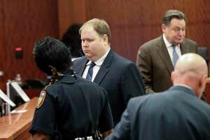 In this Aug. 27, 2019, file photo, Ronald Haskell, center, appears in Judge George Powell's courtroom for his capital murder trial in Houston. A jury has convicted Haskell of capital murder for fatally shooting six members of his ex-wife's family in Texas. Jurors on Thursday, Sept. 26, 2019, rejected Ronald Lee Haskell's insanity defense. His attorneys said Haskell believed voices in his head were telling him to kill the Stay family, including four children, at their suburban Houston home in 2014.