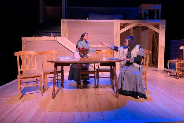 "Sierra Salazar, left, portrays 6-year-old Helen Keller and Rheagan Higgins plays her teacher, Annie Sullivan, in Shadow Creek Ranch High School's production of ""The Miracle Worker."""