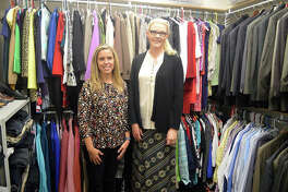 Carrie Smolar, left, assistant director for employer relations at SIUE's Career Development Center, and Megan Gilbert, a career counselor for the CDC, pose inside the Cougar Career Closet, located on the lower level of SIUE's Student Success Center.