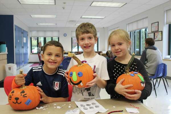 New Canaan YMCA Vacation Camp participants spent their recent day off from school decorating pumpkins. Contributed photo
