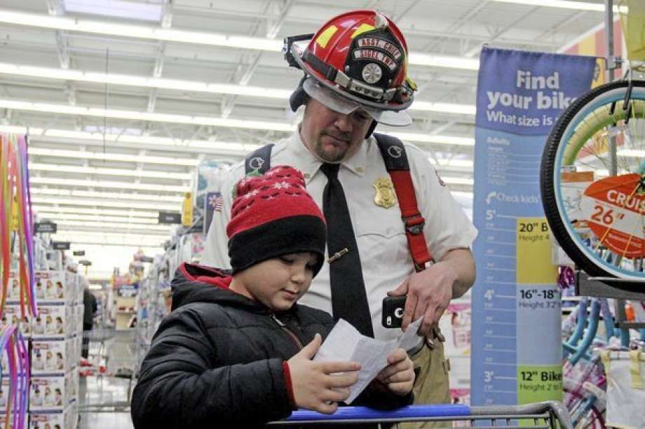 Last year, the return of Shop with a Hero was a triumphant one. The Bad Axe Police Department will be hosting two fundraising events in the coming weeks to benefit the program. Here are some scenes from last year's Shop with a Hero. Photo: Tribune File Photo