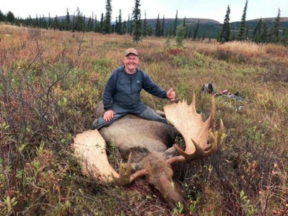 Greg Talaski poses for a photo with a moose he shot Sept. 12. (Submitted to the Tribune)