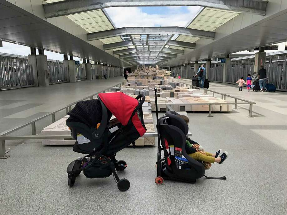 You can put a car seat and stroller together for a travel system for infants or toddlers, as this photo taken at Austin-Bergstrom International Airport shows. On the left, a Chicco Fit2 on a Mountain Buggy Nano stroller. On the right, a Clek Fllo convertible car seat on a Go-Go Babyz Travelmate. Photo: Courtesy Of Shannon Corliss / Courtesy of Shannon Corliss