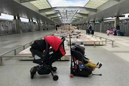You can put a car seat and stroller together for a travel system for infants or toddlers, as this photo taken at Austin-Bergstrom International Airport shows. On the left, a Chicco Fit2 on a Mountain Buggy Nano stroller. On the right, a Clek Fllo convertible car seat on a Go-Go Babyz Travelmate.