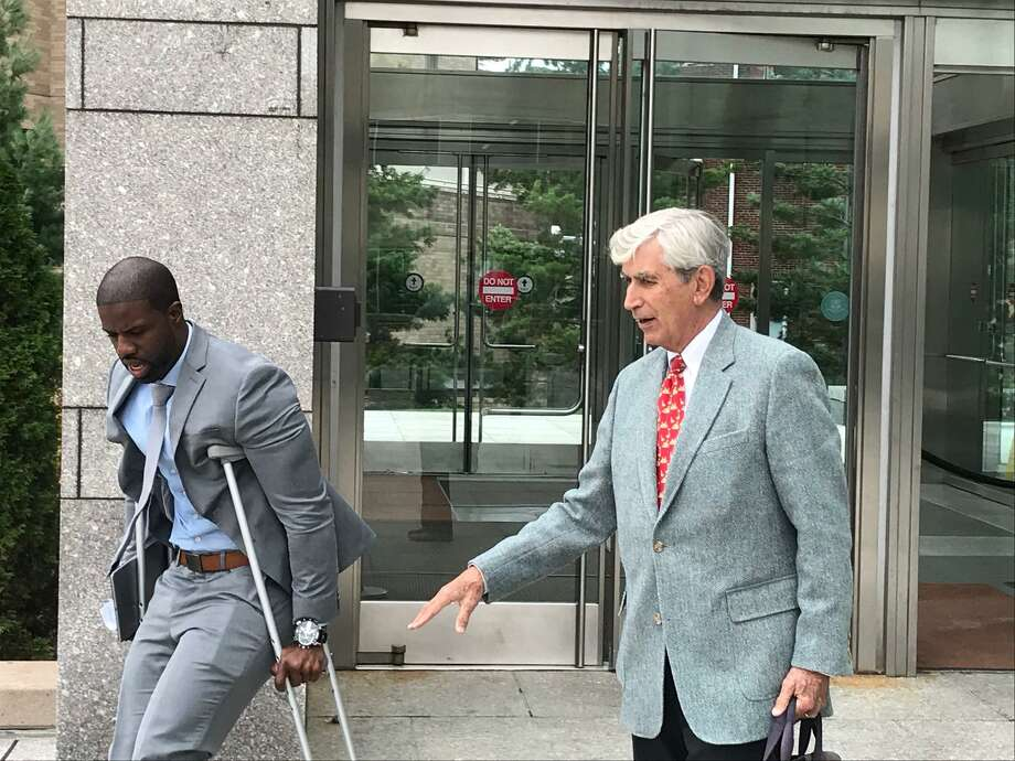 Attorney James Hardy, left, with his criminal defense attorney William Dow leaving the Stamford courthouse on Friday morning. Photo: John Nickerson / Hearst Connecticut Media