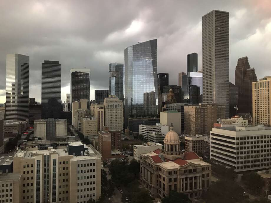 Clouds move into downtown as a cold front arrives Thursday, Oct. 11, 2019 in Houston. Photo: Melissa Phillip/Staff Photographer