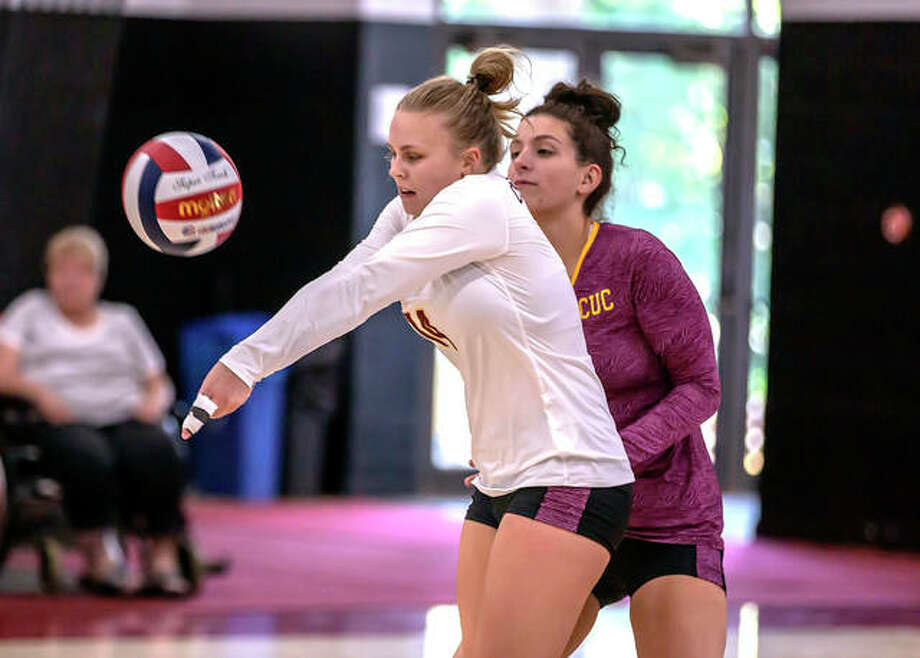 Concordia University Chicago's Emily Schwarz, left, receives a serve during a match last season. Schwarz is a 2018 graduate of Metro-East Lutheran High School. Photo: Concordia University Chicago
