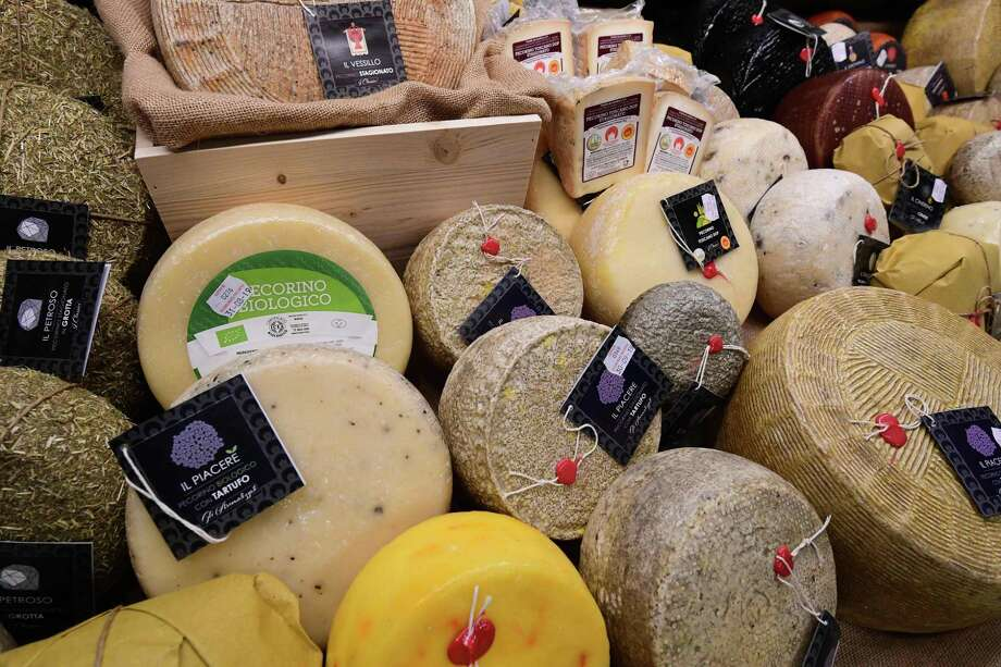 (FILES) In this file photo taken on May 7, 2019 Pecorino cheeses produced by Rocca Toscana Formaggi are displayed at the TUTTOFOOD fair, the international B2B show dedicated to food and beverage, in Milan. - From whisky and wine to parkas and cashmere sweaters to cheese, the US has released a list of imported European products slapped with tariffs in the battle between Washington and Brussels over aircraft subsidies. The US trade representatives list includes more than 150 products, principally from Germany, France, Spain and the UK, but also across Europe, that will face a 25 percent tariff from October 18. (Photo by Miguel MEDINA / AFP) (Photo by MIGUEL MEDINA/AFP via Getty Images) Photo: MIGUEL MEDINA / AFP Via Getty Images / AFP or licensors