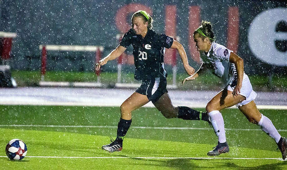 SIUE's Courtney Benning (20) drives against a Belmont player in the pouring rain Thursday night at Korte Stadium. The Cougars and Belmont endured a two-hour weather delay in the second half before playing to a 3-3 tie in double overtime. Photo: SIUE Athletics