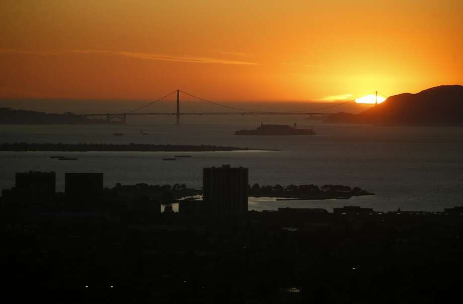 The sun sets over the Marin Headlands and Golden Gate Bridge in this view from Hiller Drive in Oakland, Calif., on Wednesday, Oct. 9, 2019. This area was the scene of the devastating 1991 Oakland firestorm. (Photo by Jane Tyska/MediaNews Group/The Mercury News via Getty Images) Photo: MediaNews Group/The Mercury News/MediaNews Group Via Getty Images