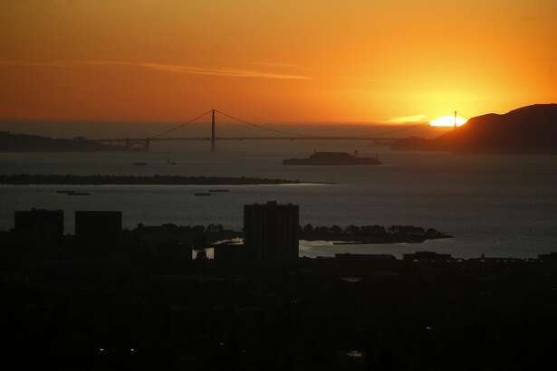 The sun sets over the Marin Headlands and Golden Gate Bridge in this view from Hiller Drive in Oakland, Calif., on Wednesday, Oct. 9, 2019. This area was the scene of the devastating 1991 Oakland firestorm. (Photo by Jane Tyska/MediaNews Group/The Mercury News via Getty Images)
