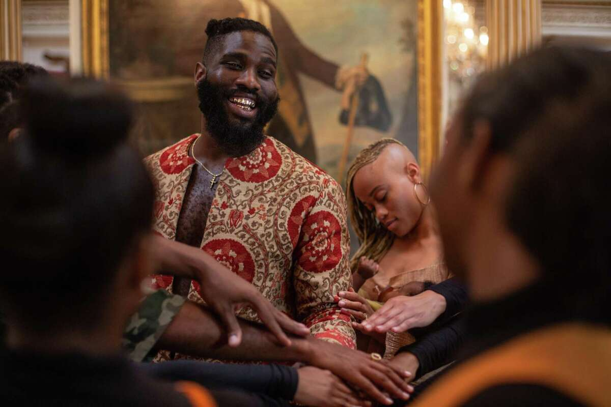Tobe Nwigwe shares a moment with his crew as production for the video wraps at the Rienzi museum and art gallery on Wednesday August 28, 2019 in Houston.