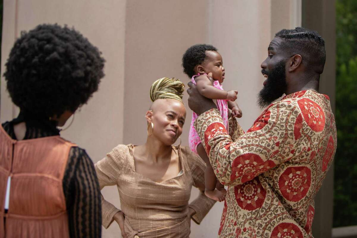 Fat, Ivory and Tobe Nwigwe share a moment during some downtime on the set of Tobe Nwigwe's video shoot at the Rienzi museum and art gallery on Wednesday August 28, 2019 in Houston.