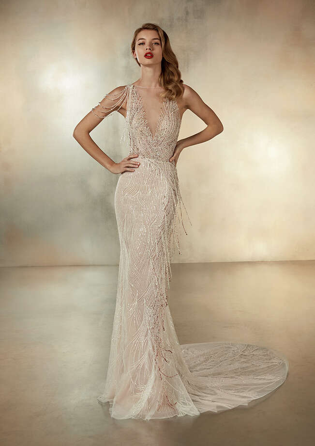The Universe is on display inside the Provonias boutique inside the Galleria. Click through the gallery above to see some of the other wedding gowns currently on display at Pronovias Boutique Houston in the Galleria. Photo: Courtesy Pronovias Boutique Houston