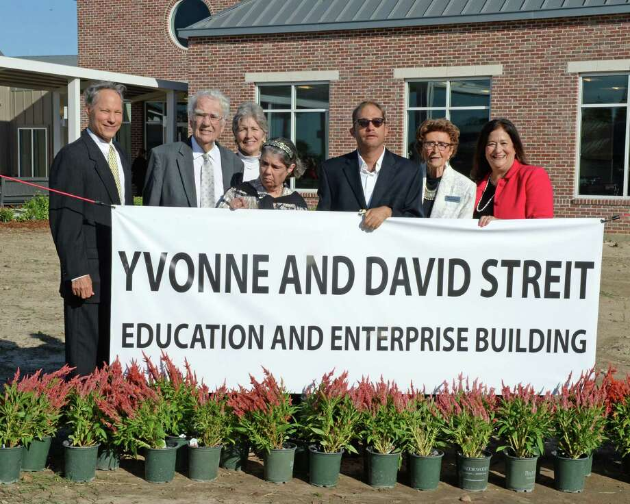 From left are Neal Shudde, David Streit, Vita Goodell, Citizens Vicki Streit and Wilson Shudde, Founder Yvonne Streit, CEO Vivian Shudde as they pose at the opening of the Yvonne and David Streit Education and Enterprise Building in Brookshire on Thursday, Oct. 10. Photo: Craig Moseley, Houston Chronicle / Staff Photographer / ©2019 Houston Chronicle
