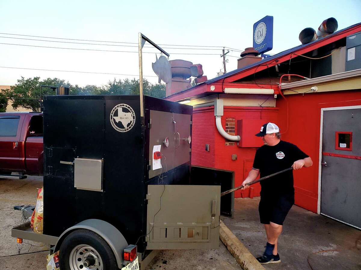 Russell Roegels tends the whole-hog pit at Roegels Barbecue Co.