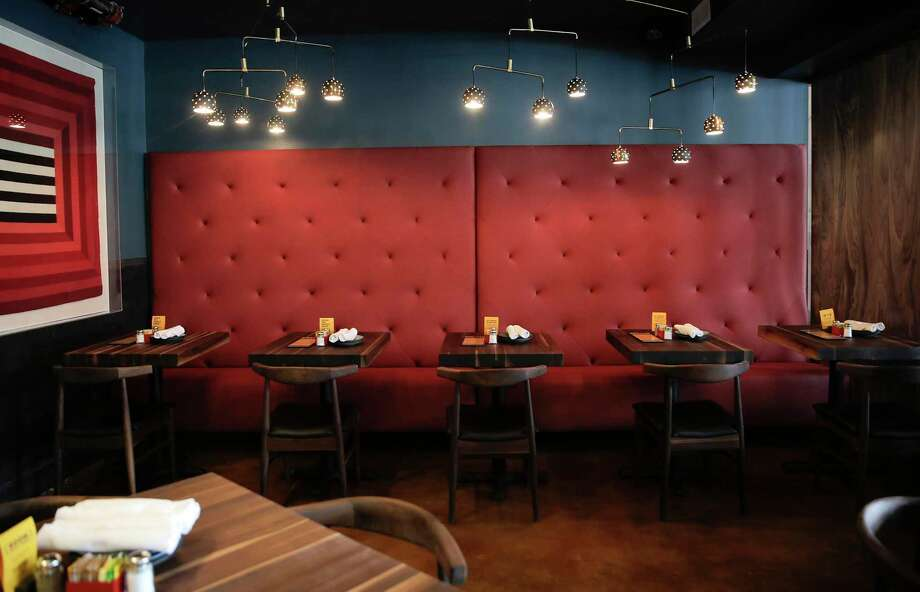 Seating area in Postino WineCafe's second Houston location on Tuesday, Sept. 10, 2019 in Houston. The restaurant and wine shop will open next week in Montrose, the former home of the Montrose Mining Company, Houston's longest-running gay bar. Postino's owner has created a preservation-minded design that pays homage to the spirit of the neighborhood. Photo: Elizabeth Conley, Houston Chronicle / Staff Photographer / © 2018 Houston Chronicle