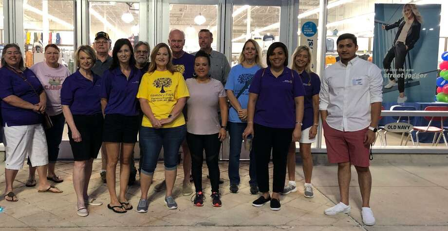 "Lake Conroe Rotarians and family members gathered before dawn at Old Navy in Conroe for their annual ""Clothing for Kids"" event. Also pictured is Daniel (in the white shirt), part of the Old Navy Management Team. Photo: Courtesy Photo"