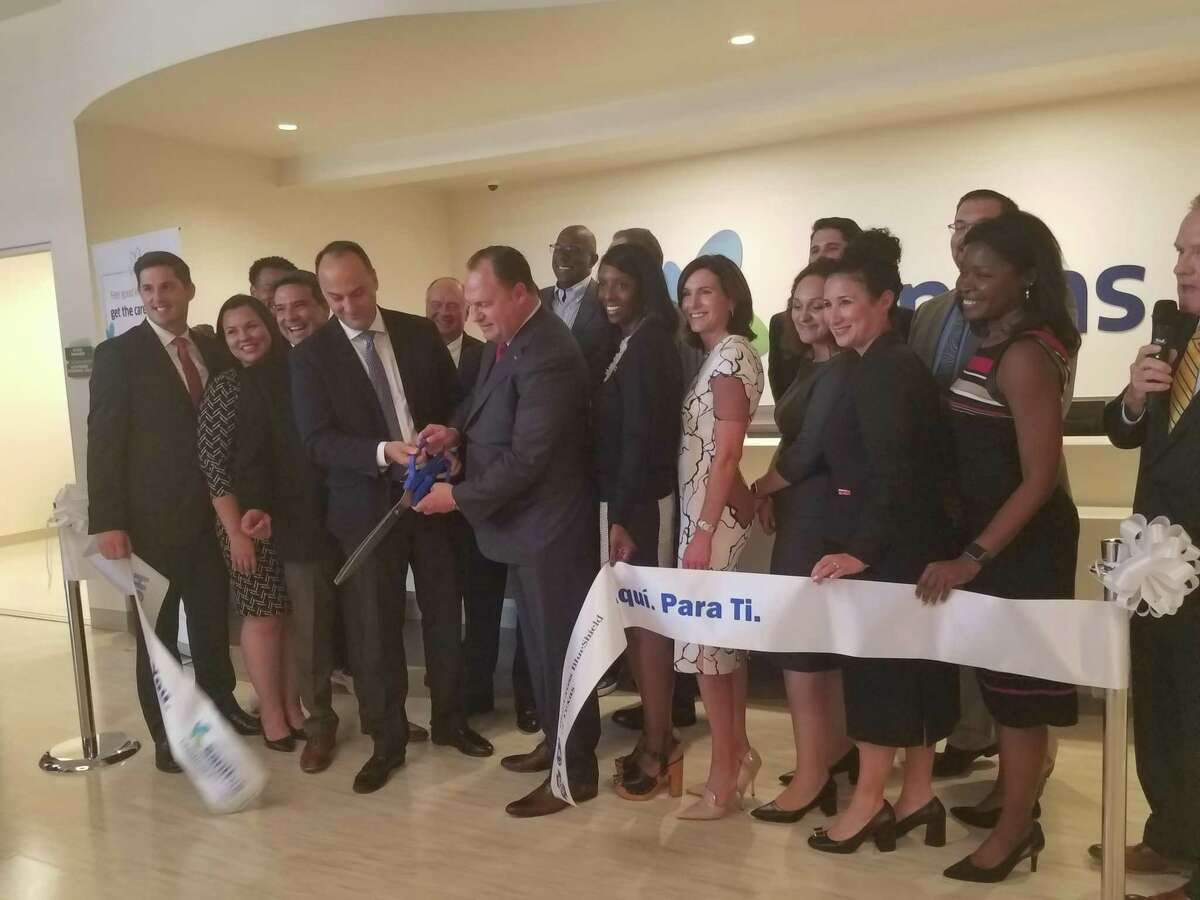 Representatives from Blue Cross Blue Shield, Sanitas, the City of Katy and the Katy Area Chamber of Commerce dedicate the new healthcare facility with a ribbon cutting.