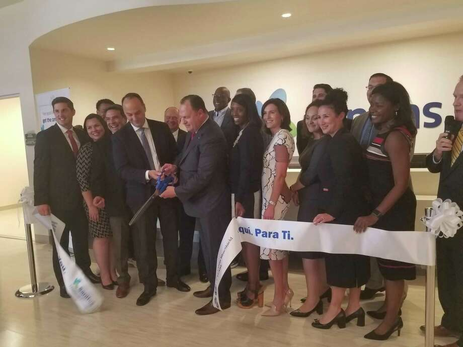 Representatives from Blue Cross Blue Shield, Sanitas, the City of Katy and the Katy Area Chamber of Commerce dedicate the new healthcare facility with a ribbon cutting. Photo: Claire Goodman