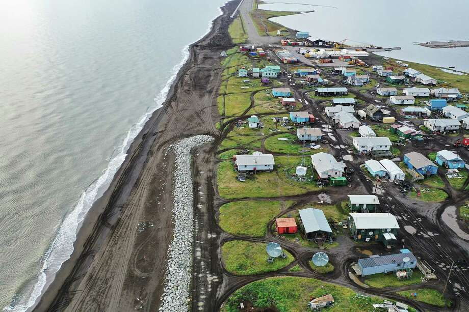 An aerial view from a drone shows Kivalina, Alaska, which is at the end of an eight-mile barrier reef located between a lagoon and the Chukchi Sea. The village is 83 miles above the Arctic circle. Kivalina and a few other native coastal Alaskan villages face the warming of the Arctic, which has resulted in the loss of sea ice that buffers the islands shorelines from storm surges and coastal erosion. Photo: Getty Images / 2019 Getty Images