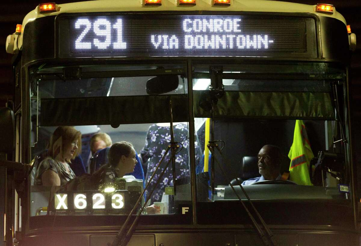 Commuters board the Metropolitan Transit Authority Route 291 at a stop beneath Interstate 45 near FM 2854 on Aug. 19, 2019, in Conroe. Additional park and ride service is a part of Metro's long-range transit plan.