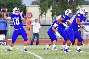 Olton quarterback Jack Allcorn gets protection from Juan Carlos Pedroza (58), Josue Castro-Barajas (33) and Josh Coronado during their non-district football game against Lockney on Sept. 27