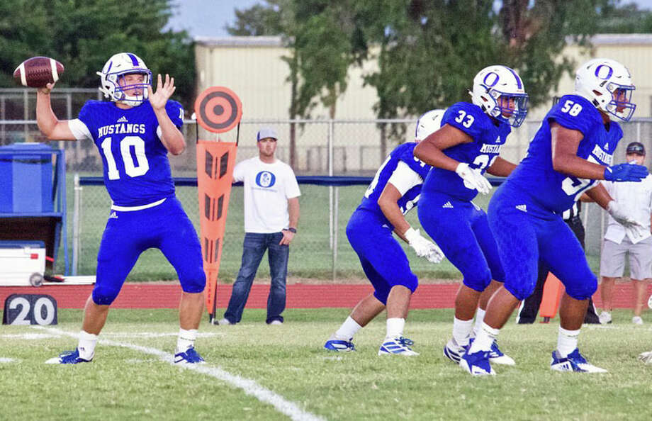 Olton quarterback Jack Allcorn gets protection from Juan Carlos Pedroza (58), Josue Castro-Barajas (33) and Josh Coronado during their non-district football game against Lockney on Sept. 27 Photo: Don Brown/For The Herald