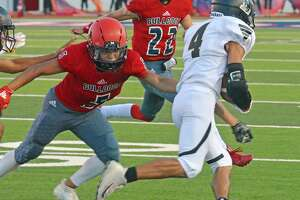 Plainview's Jaidyn Luera (5) and Michael Rhoades (22) try to bring down a Lubbock ball carrier during their non-district football game earlier this season. Luera, Rhoades and the Bulldog defense will be tested greatly against #6 Lubbock Cooper in their District 2-5A opener.