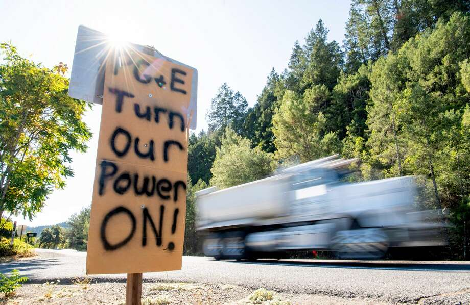 A sign calling for PG&E to turn the power back on is seen on the side of the road during a statewide blackout in Calistoga, California, on October, 10, 2019. Photo: JOSH EDELSON/AFP Via Getty Images