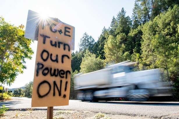 A sign calling for PG&E to turn the power back on is seen on the side of the road during a statewide blackout in Calistoga, California, on October, 10, 2019 - Rolling blackouts set to affect millions of Californians began October 9, as Pacific Gas & Electric started switching off power to an unprecedented number of households in the face of hot, windy weather that raises the risk of wildfires. PG & E, which announced the deliberate outage, is working to prevent a repeat of a catastrophe last November in which faulty power lines it owned were determined to have sparked California's deadliest wildfire in modern history. (Photo by Josh Edelson / AFP) (Photo by JOSH EDELSON/AFP via Getty Images)