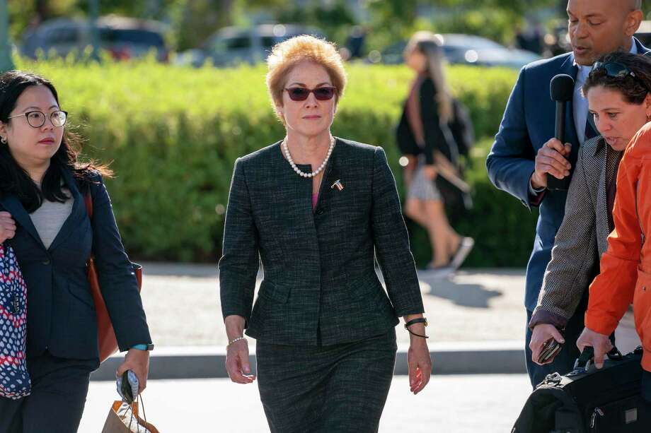 Former U.S. ambassador to Ukraine Marie Yovanovitch, center, arrives on Capitol Hill, Friday, Oct. 11, 2019, in Washington, as she is scheduled to testify before congressional lawmakers on Friday as part of the House impeachment inquiry into President Donald Trump. Photo: J. Scott Applewhite / Associated Press / Copyright 2019 The Associated Press. All rights reserved.