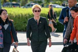 Former U.S. ambassador to Ukraine Marie Yovanovitch, center, arrives on Capitol Hill, Friday, Oct. 11, 2019, in Washington, as she is scheduled to testify before congressional lawmakers on Friday as part of the House impeachment inquiry into President Donald Trump.