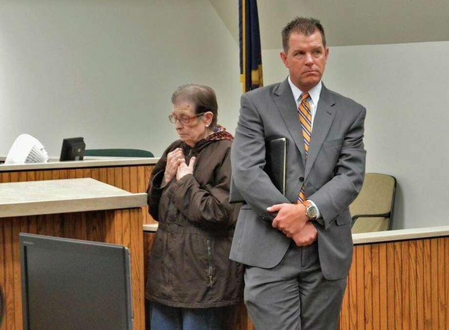 Former Mills Township clerk Maxine Brink, left, appears in 42nd Circuit Court with her attorney John Wilson on Thursday, Oct. 10, 2019. Brink was sentenced to 30 days in jail, two years probation and to pay more than $27,400 in restitution to Mills Township. (Ashley Schafer/Ashley.Schafer@hearstnp.com)