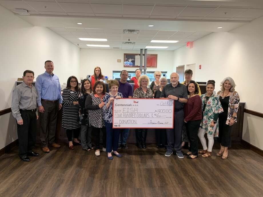 Plainview Centennial Bank gave a donation of $400 to Faith In Sharing House this week and also helped sort 3,723 pounds of canned and boxed food. Photo: Courtesy Photos/Centennial Bank