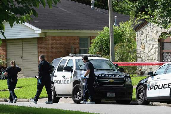 HPD officials investigate the scene where a suspect burglar broke into a house and was shot by a neighbor on the 4800 block of Ventura Lane on Tuesday, June 26, 2018, in Houston. Two teenage girls were in the house when the burglary happened. The father broke the front window to get the daughters out of the house. The adult male neighbor shot at the adult male suspect twice in the back of the house. The burglary suspect was taken to the hospital and in stable condition. ( Yi-Chin Lee / Houston Chronicle )