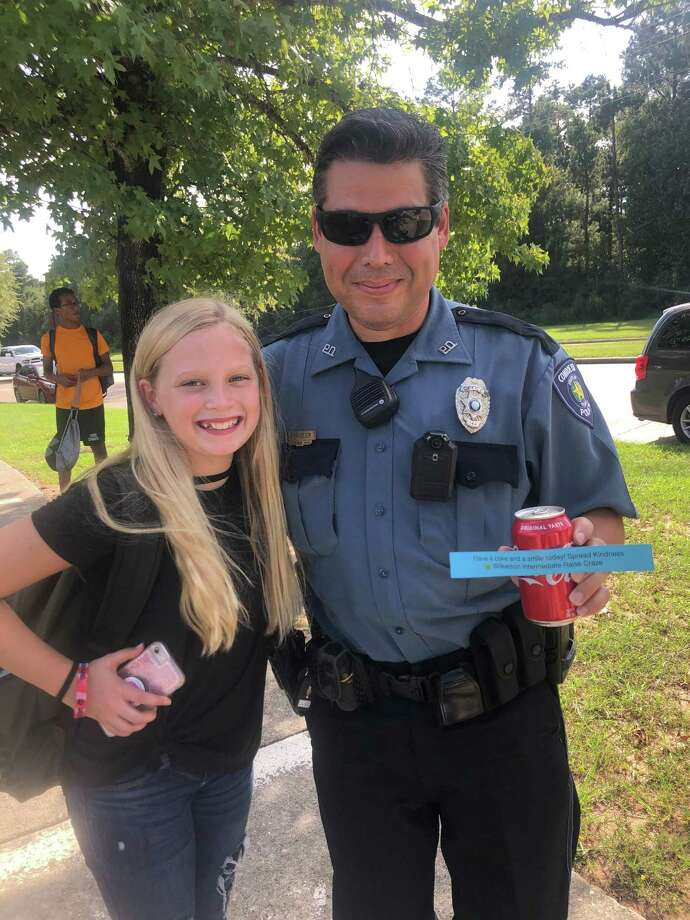 Wilkerson Intermediate School sixth grader Macie Fralix handed a cold Coke to a CISD officer on a hot afternoon after school. Photo: Provided